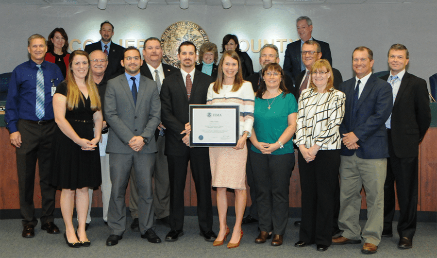 Board of County Commissioners presenting a FEMA CRS plaque to the contributing staff members.